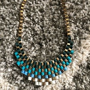 Ribbon and gold necklace
